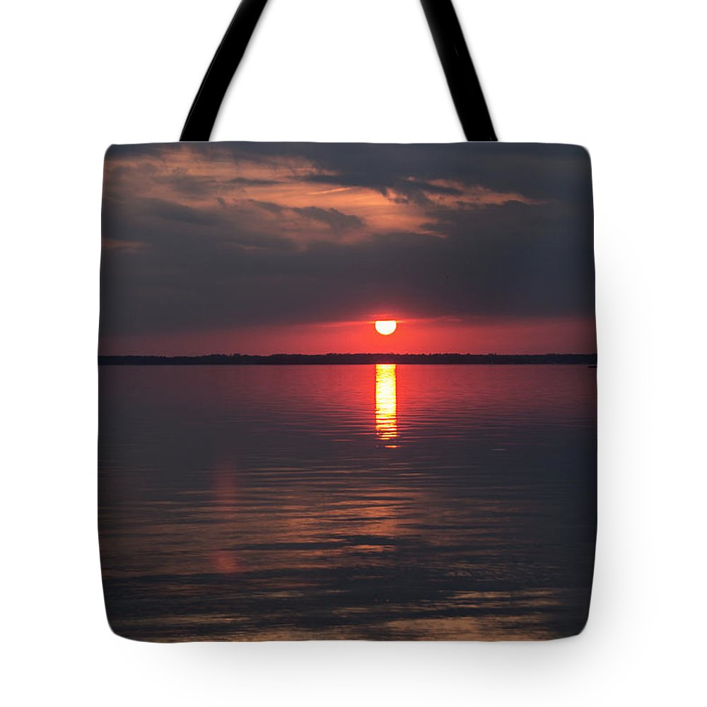 Sunset Tote Bag featuring the photograph The Sky On Fire by Arlene Carmel