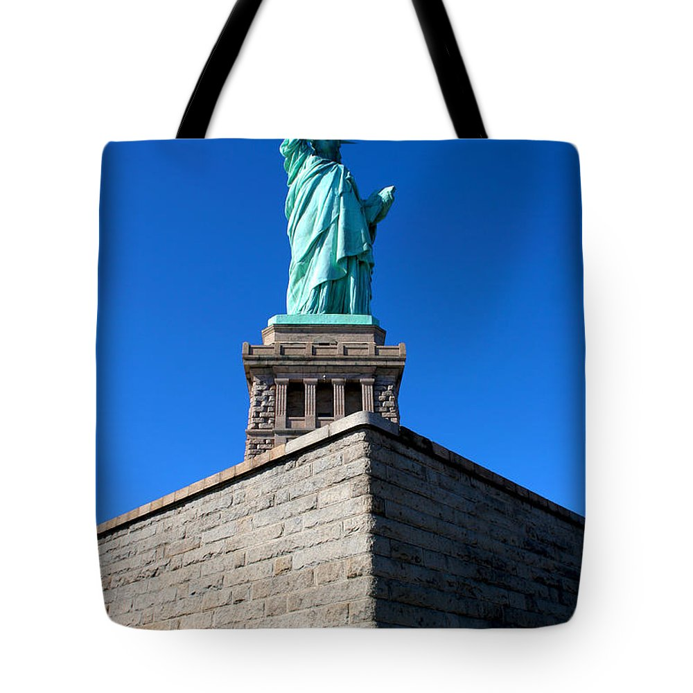 Statue Of Liberty Tote Bag featuring the photograph The Statue by Allan Lovell