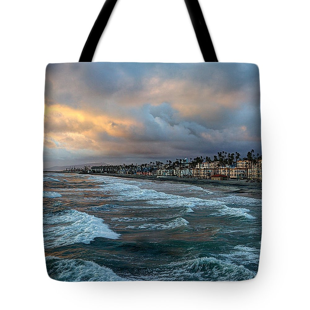 Oceanside Tote Bag featuring the photograph The Storm Clouds Roll In by Ann Patterson