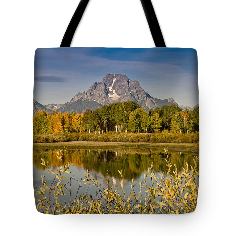 Aspen Tote Bag featuring the photograph The Tetons And Fall Colors by Jeff Goulden