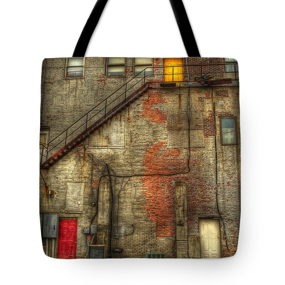 Doors Tote Bag featuring the photograph The Three Doors by Thomas Young
