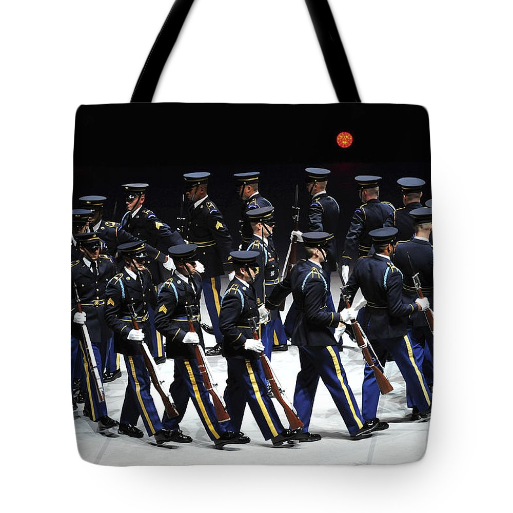 Army Tote Bag featuring the photograph The U.s. Army Drill Team Performs by Stocktrek Images