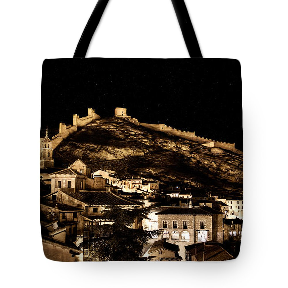 Albarracin Tote Bag featuring the photograph The Walls Of Albarracin In The Summer Night Spain by Weston Westmoreland