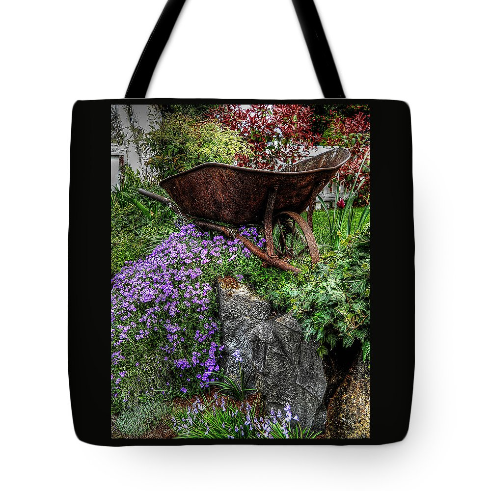 Pictures Of Flowers Tote Bag featuring the photograph The Whimsical Wheelbarrow by Thom Zehrfeld