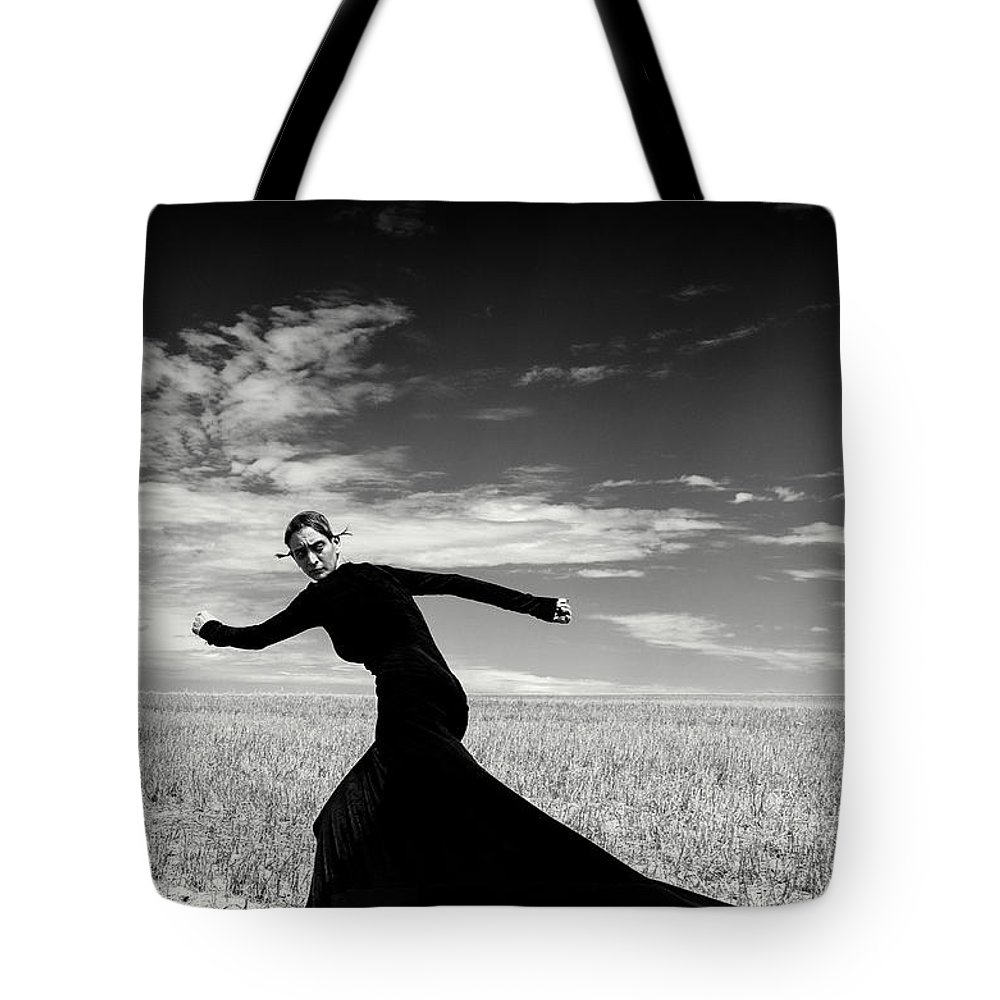 Looking Over Shoulder Tote Bag featuring the photograph The Witch by Funky-data