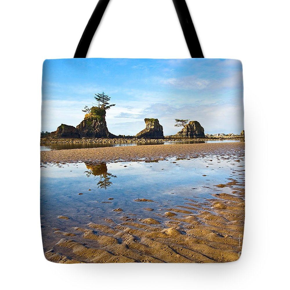 Three Brothers Tote Bag featuring the photograph Three Brothers Rock Formation Near The Oregon Coast by Jamie Pham