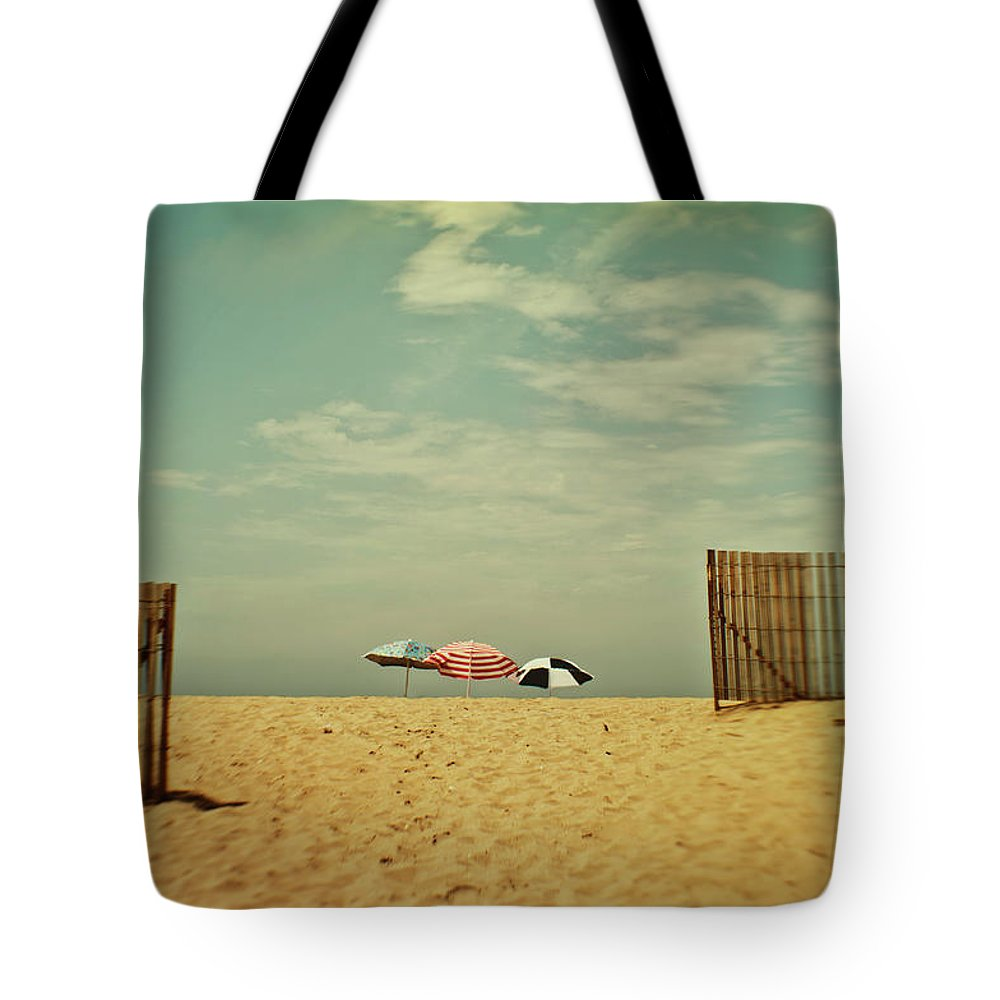 Tranquility Tote Bag featuring the photograph Three Umbrellas On The Beach by Suzanne Cummings