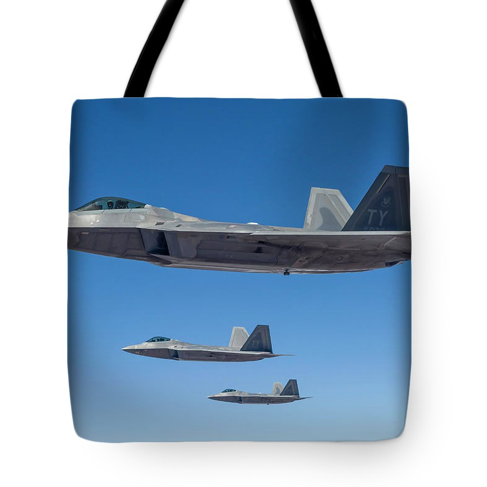 Formation Flying Tote Bag featuring the photograph Three U.s. Air Force F-22 Raptors by Rob Edgcumbe/stocktrek Images