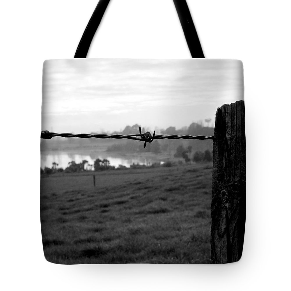Barbed Wire Landscape New Zealand Waikato Lake Post Wood Nature Farm Rural Countryside Tote Bag featuring the photograph Through The Fence by Guy Pettingell