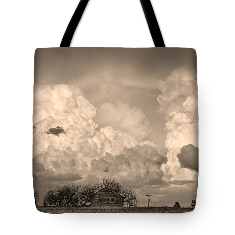 Weather Tote Bag featuring the photograph Thunderstorm Clouds And The Little House On The Prairie Sepia by James BO Insogna
