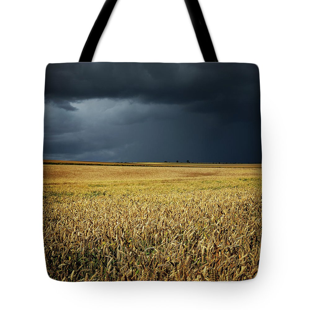 Scenics Tote Bag featuring the photograph Thunderstorm Clouds Over Wheat Field by Avtg