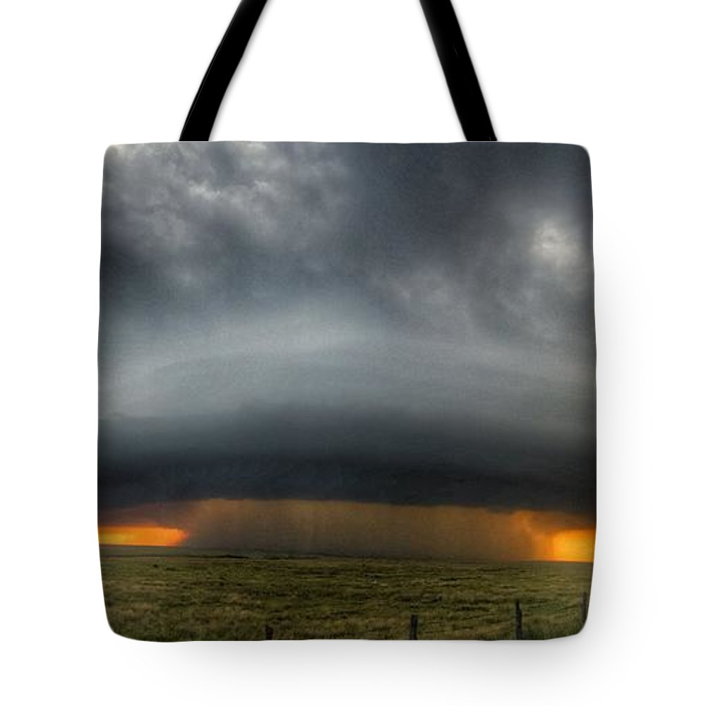 Problems Tote Bag featuring the photograph Thunderstorm Over Grassy Field by Brian Harrison / Eyeem
