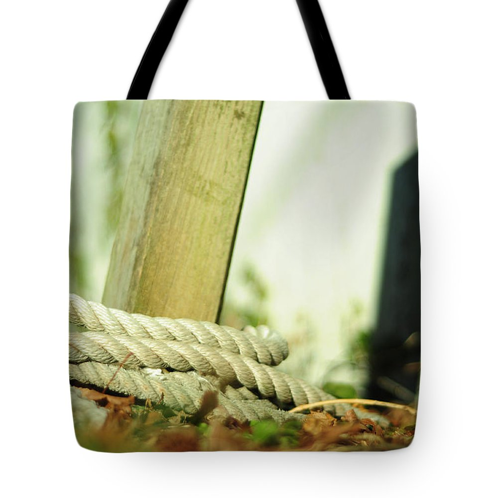 Fence Post Tote Bag featuring the photograph Ties by Rebecca Sherman