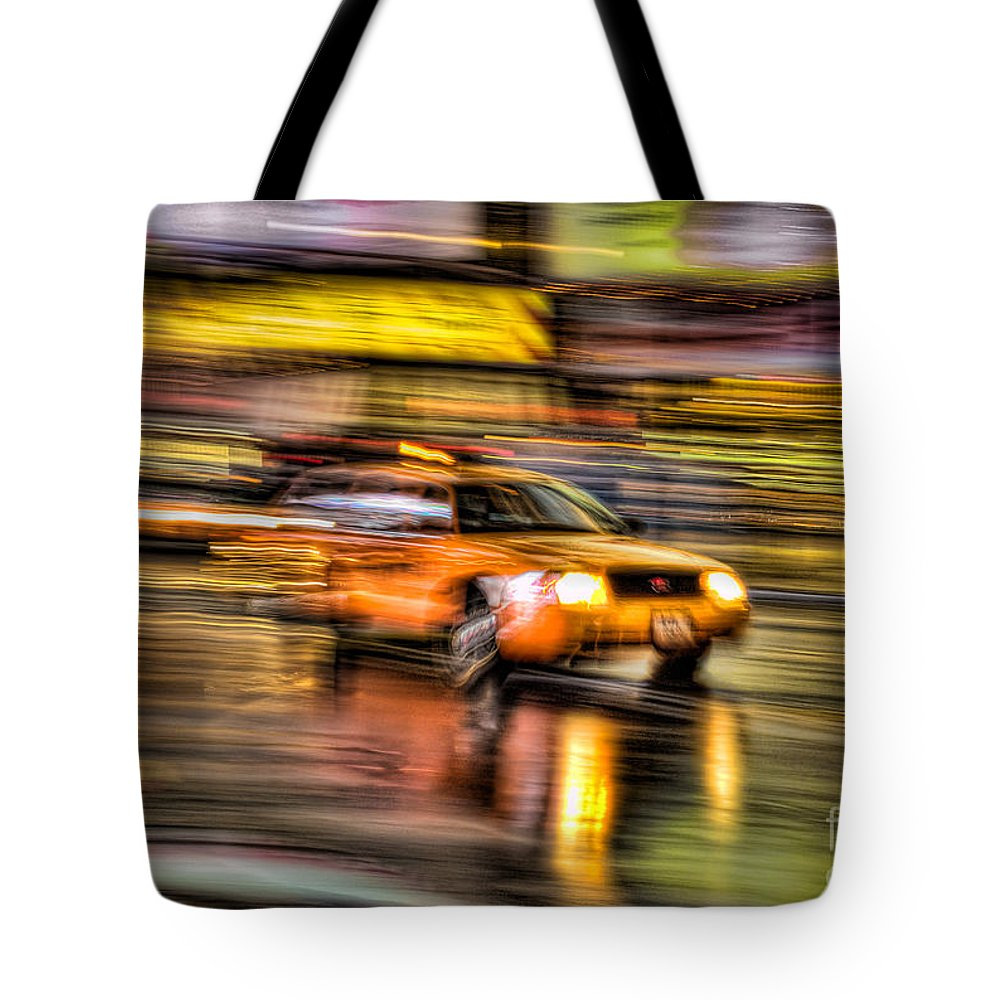 Clarence Holmes Tote Bag featuring the photograph Times Square Taxi I by Clarence Holmes