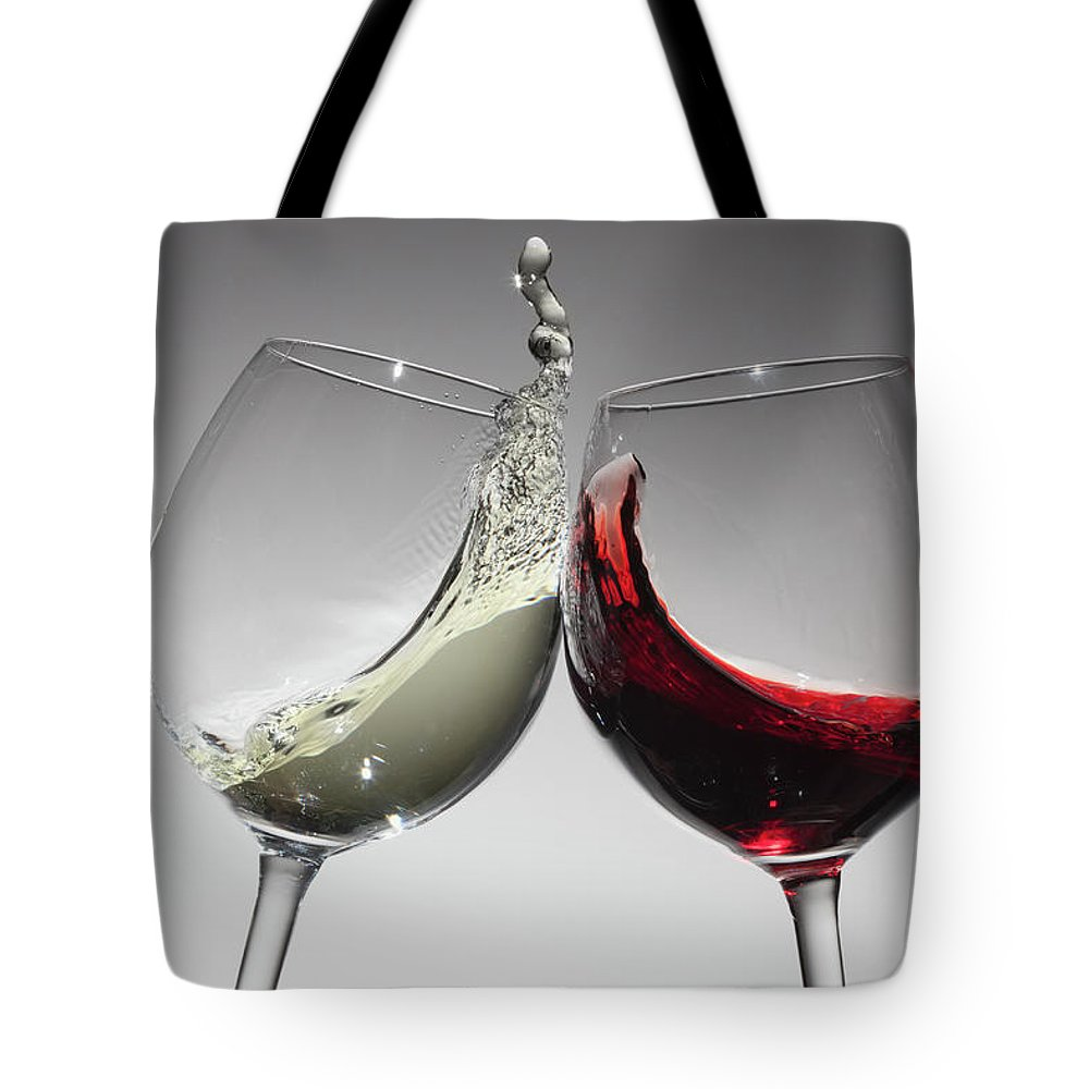 Alcohol Tote Bag featuring the photograph Toasting With Glasses Of Water And Red by Dual Dual