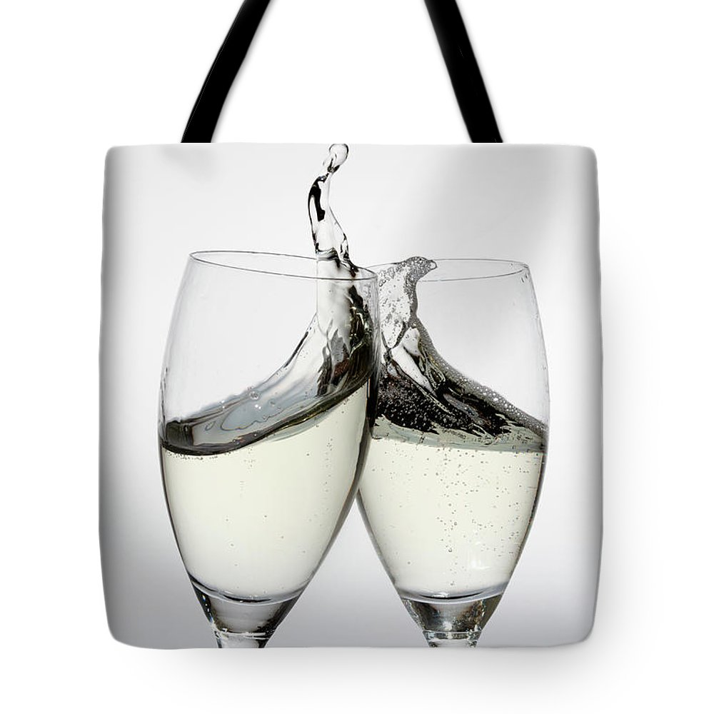 Alcohol Tote Bag featuring the photograph Toasting With Two Glasses Of Champagne by Dual Dual
