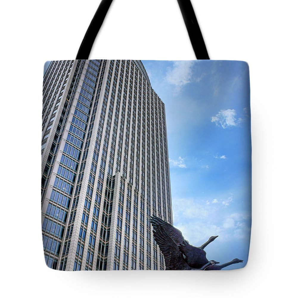 First National Tower Tote Bag featuring the photograph Tower And Geese by Nikolyn McDonald