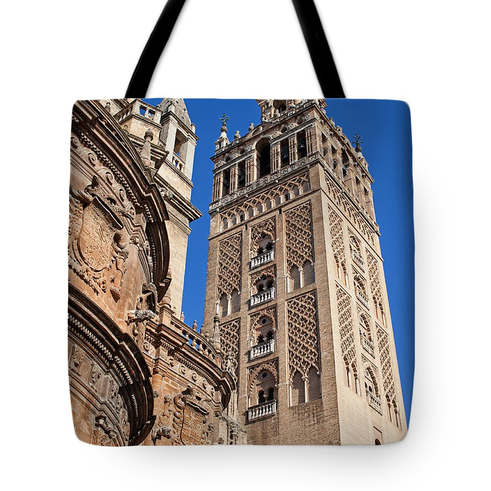 Almohad Tote Bag featuring the photograph Tower Of The Seville Cathedral by Artur Bogacki