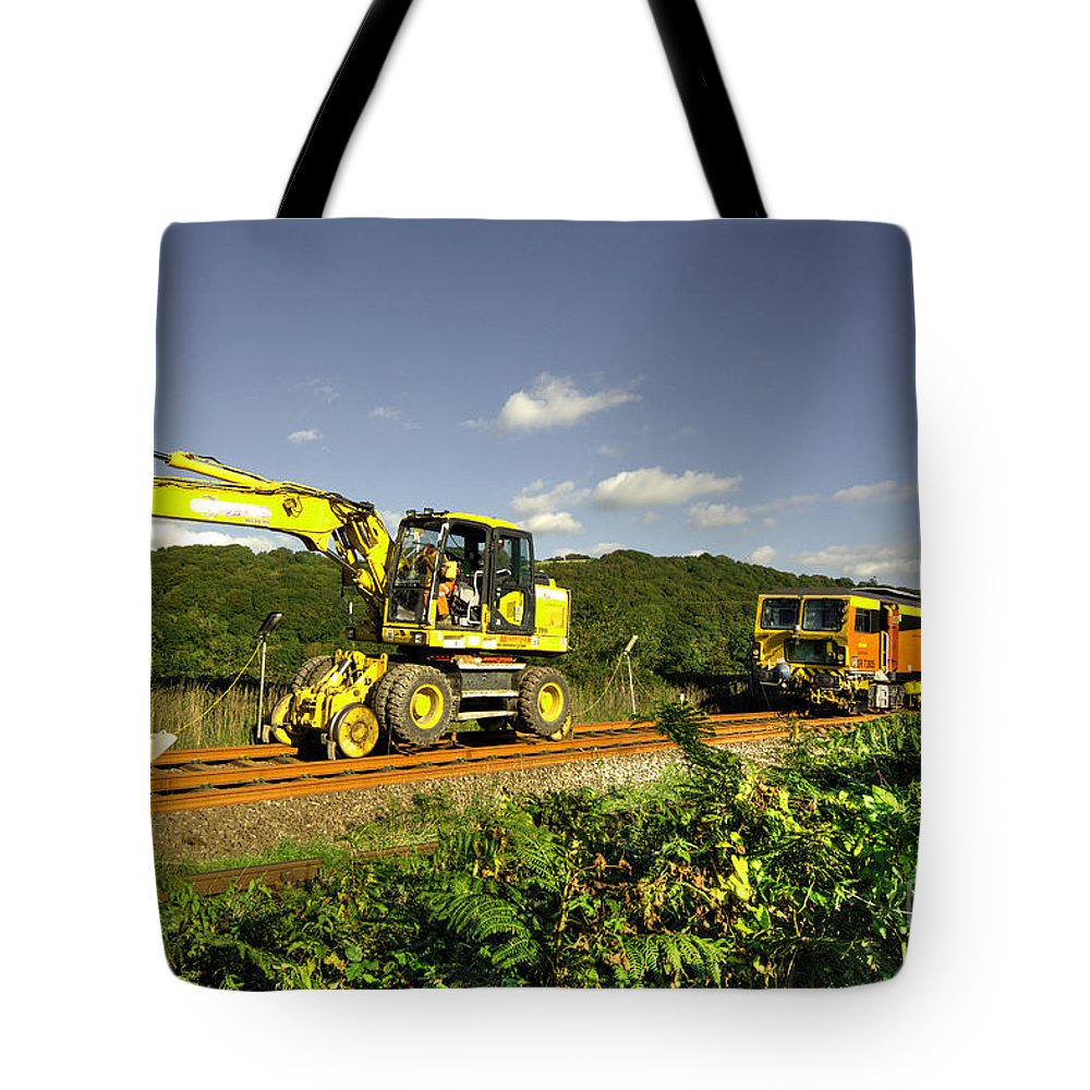 Track Tote Bag featuring the photograph Track Machines by Rob Hawkins