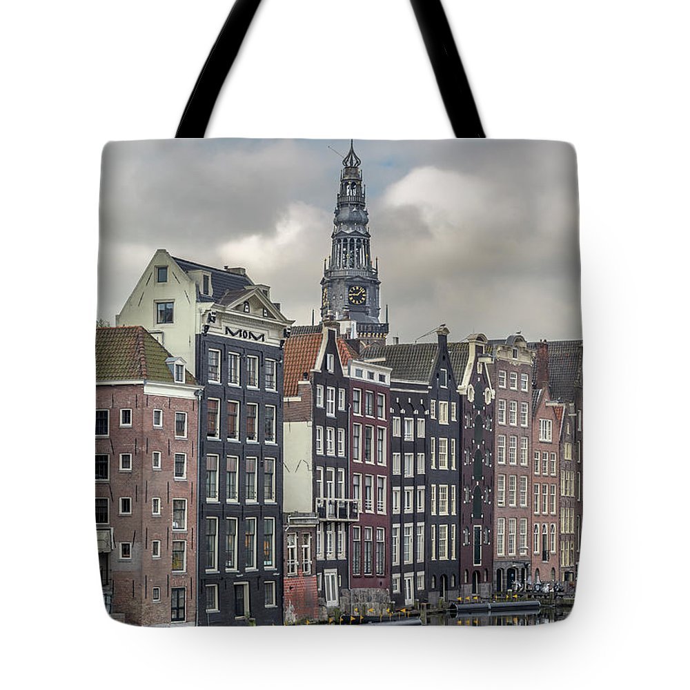 In A Row Tote Bag featuring the photograph Traditional Dutch Houses Over A Canal by Buena Vista Images