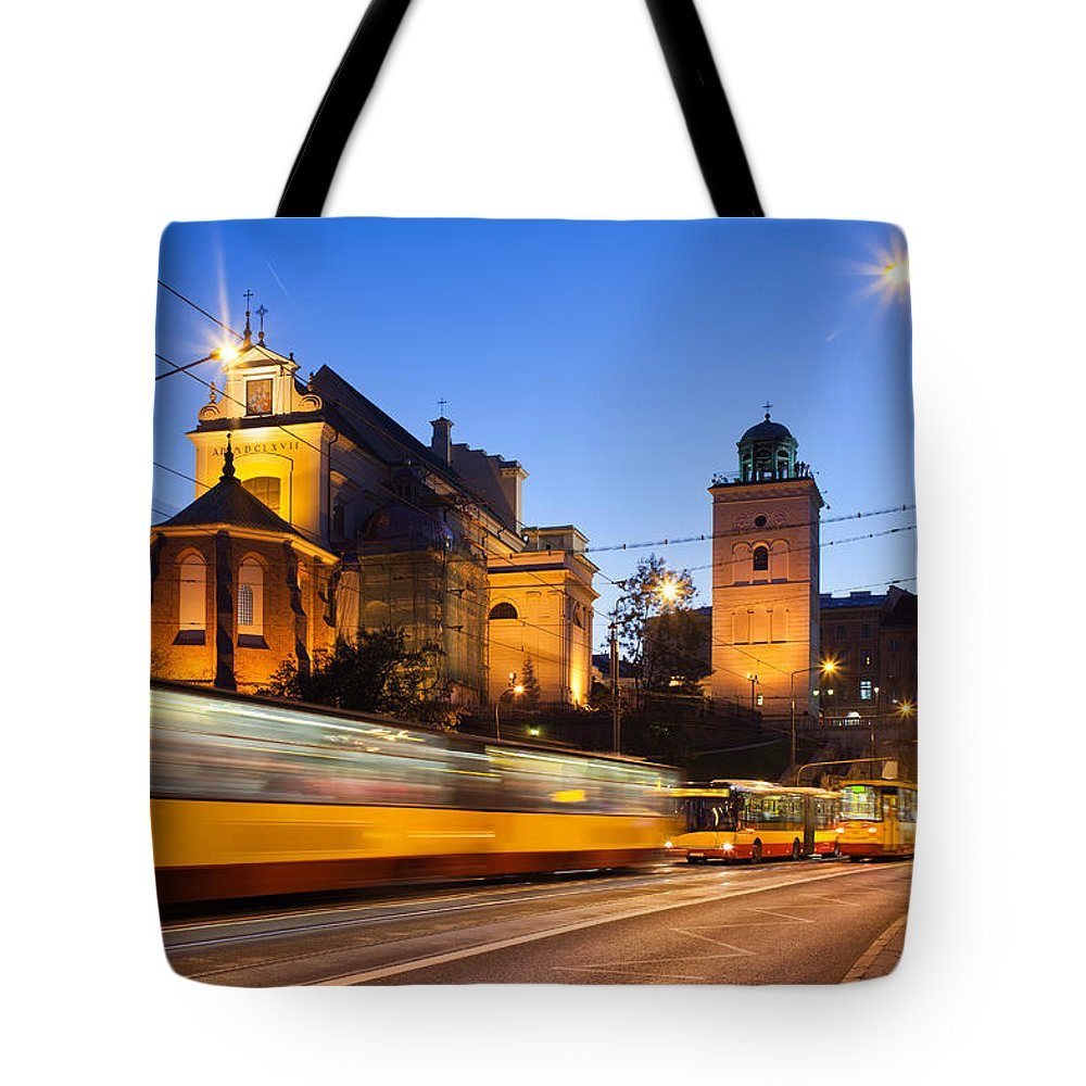 City Tote Bag featuring the photograph Traffic On The Solidarity Avenue In Warsaw by Artur Bogacki