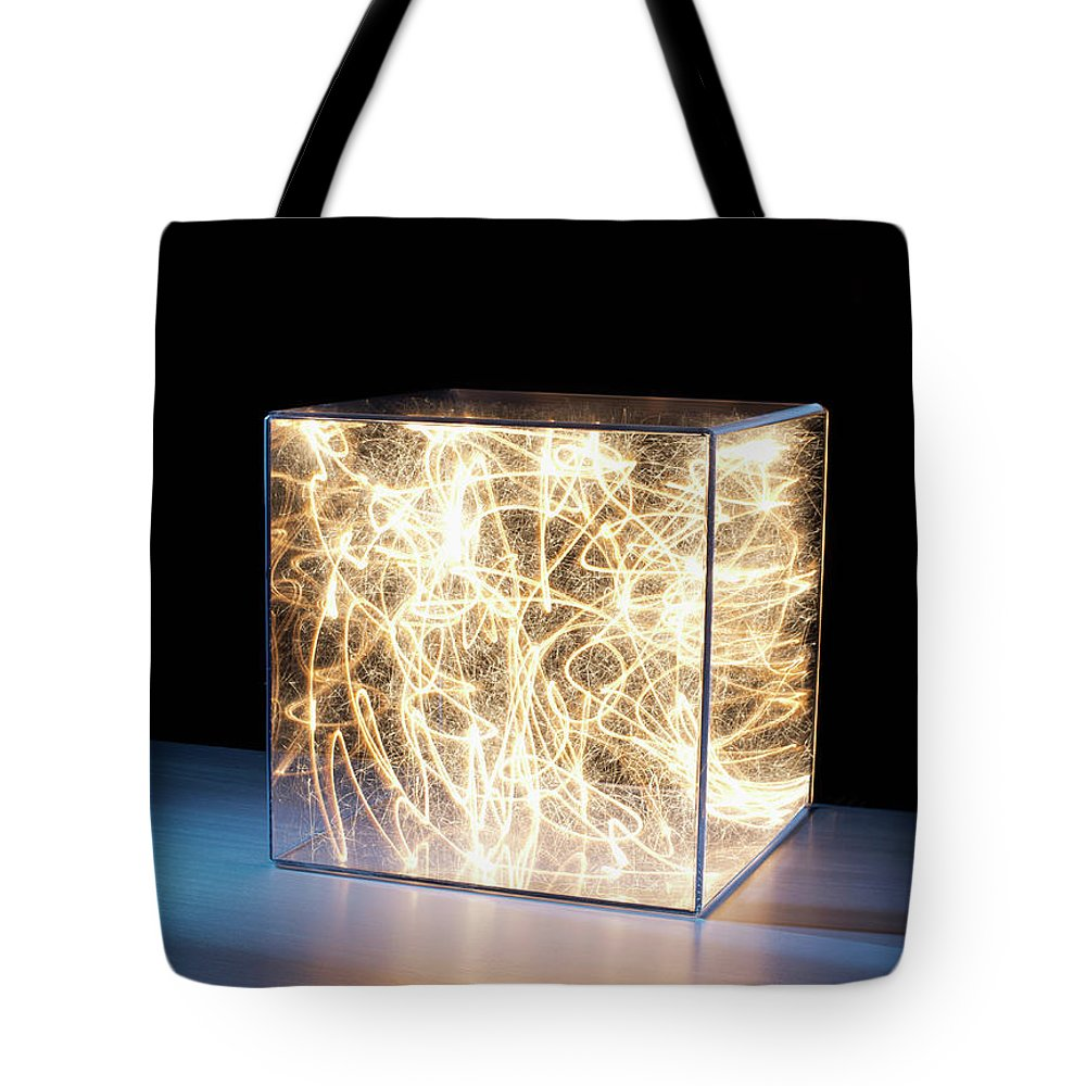 Block Shape Tote Bag featuring the photograph Trail Of Bright Light In Box by Pm Images