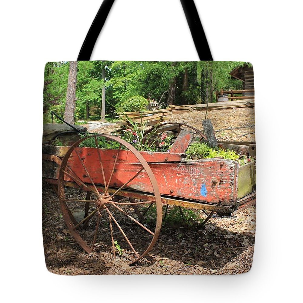 Red Trailer Tote Bag featuring the photograph Trailer Flowerbed by Mary Koval