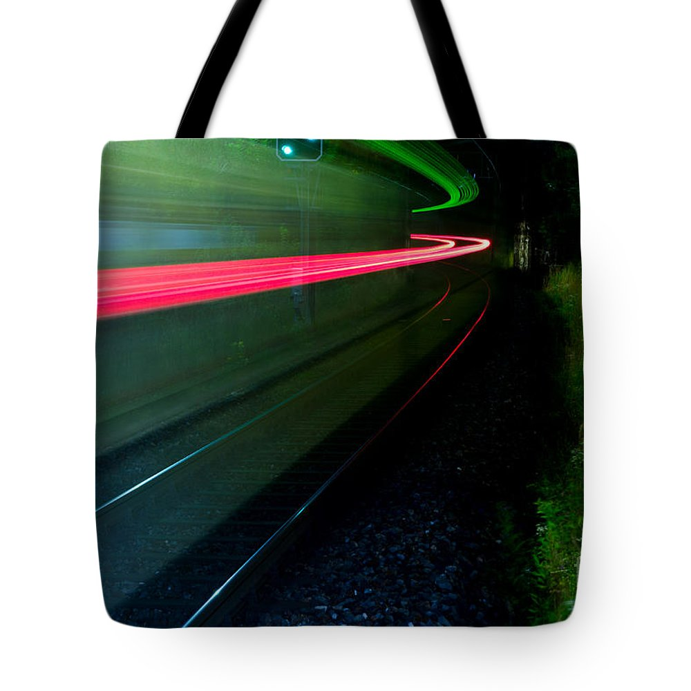 Train Tote Bag featuring the photograph Train Pass By by Mats Silvan