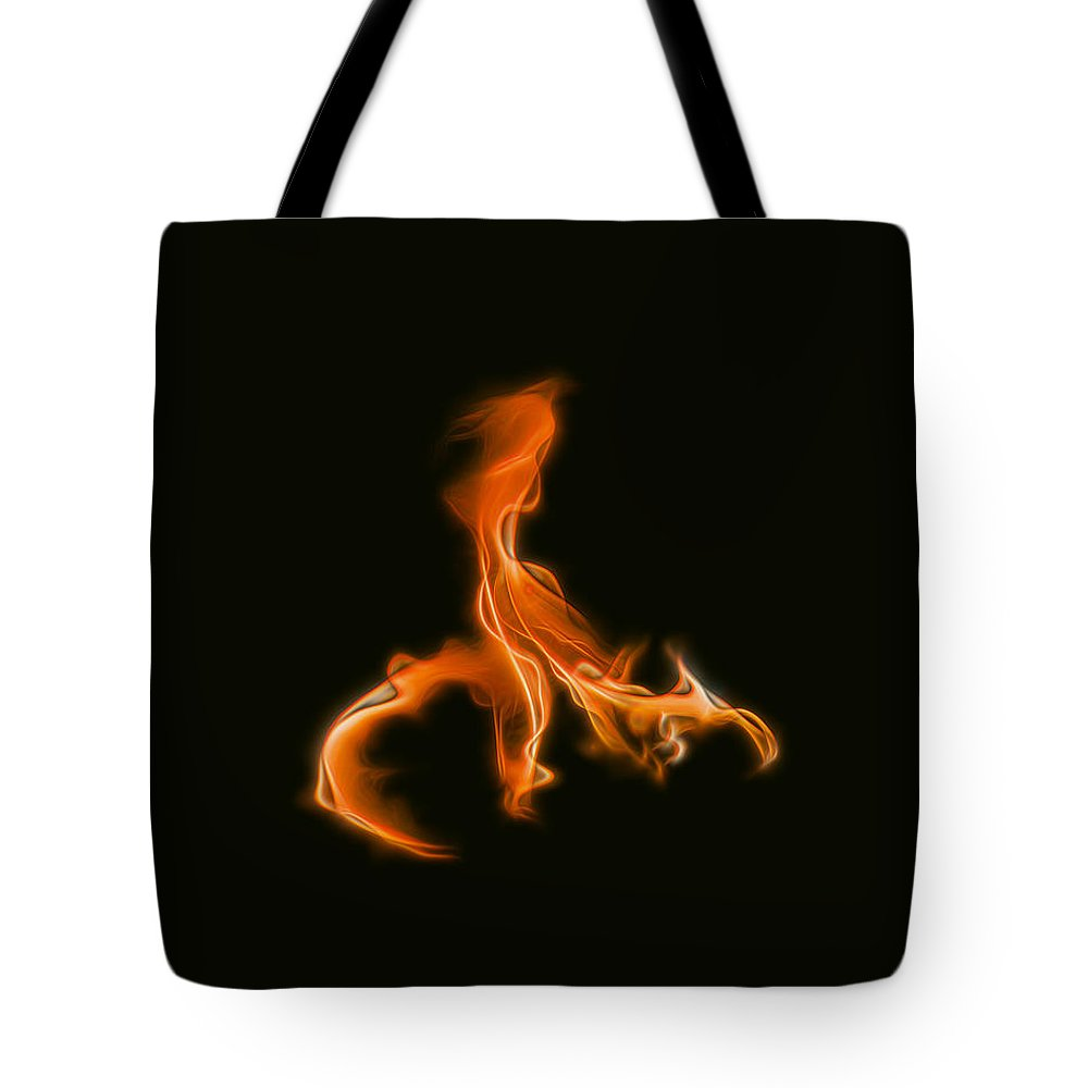 Fire Tote Bag featuring the photograph Trial By Fire by Wes Jimerson
