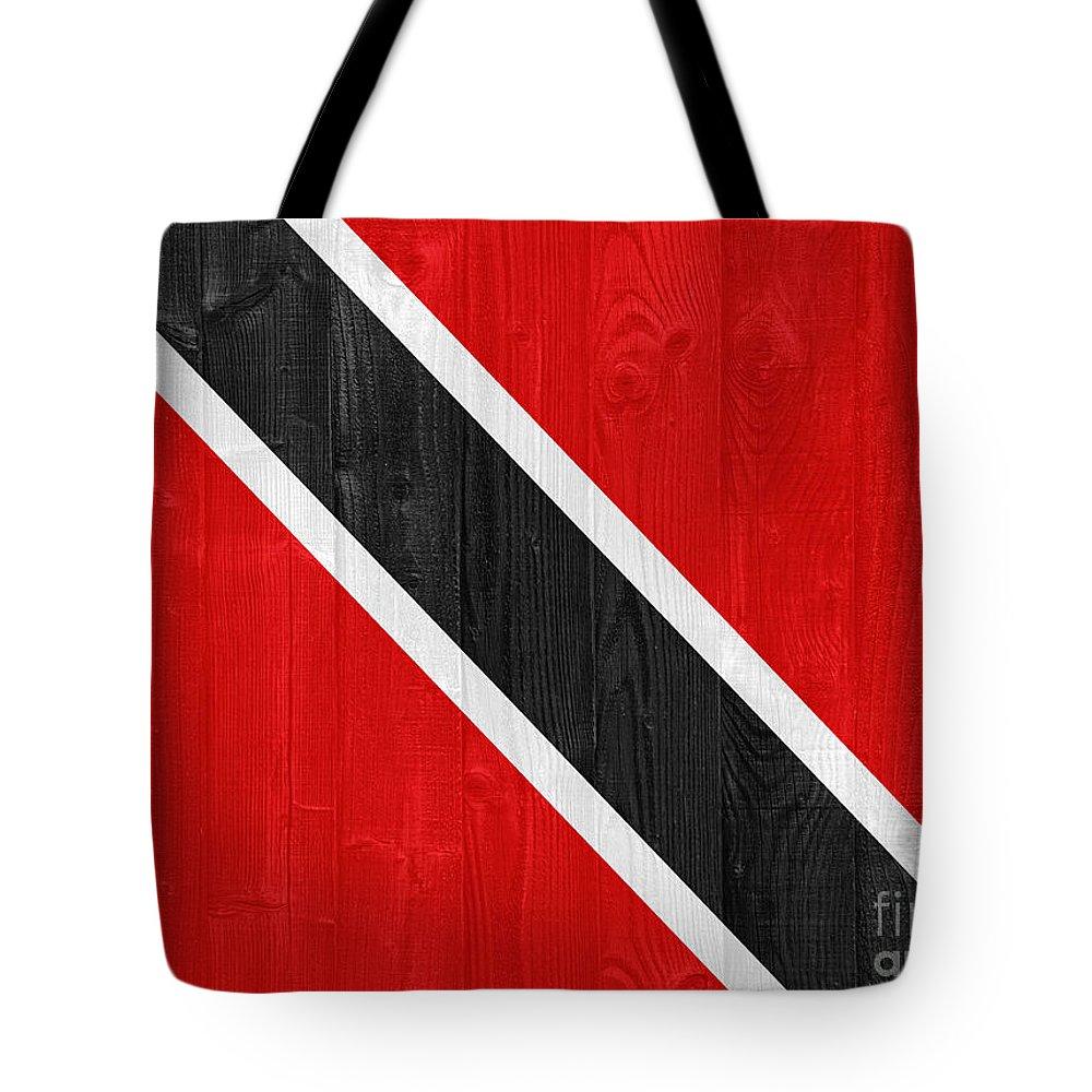 Trinidad Tote Bag featuring the photograph Trinidad And Tobago Flag by Luis Alvarenga