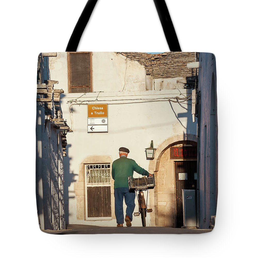 People Tote Bag featuring the photograph Trulli Houses Alberobello Apulia Puglia by Peter Adams