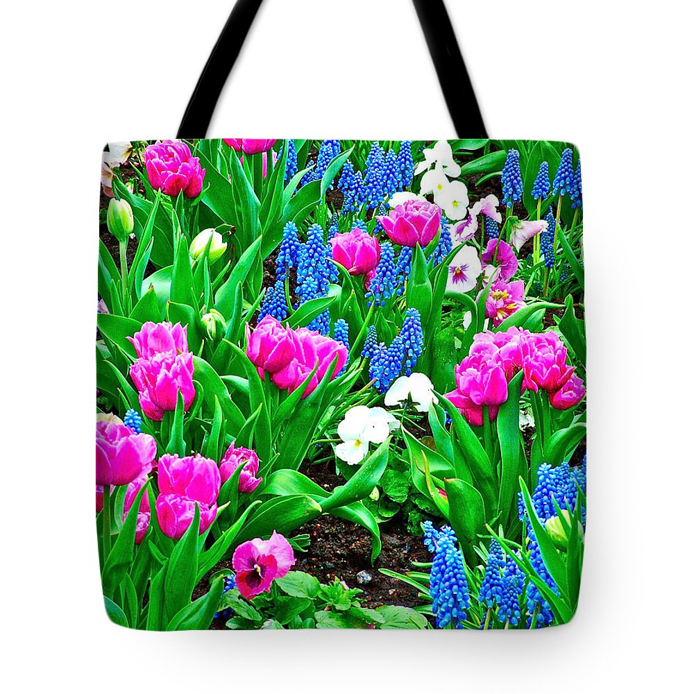 Tulips And Pansies And Grape Hyacinths By Lutheran Cathedral Of Helsinki Tote Bag featuring the photograph Tulips And Pansies And Grape Hyacinth By Lutheran Cathedral Of Helsinki-finland by Ruth Hager