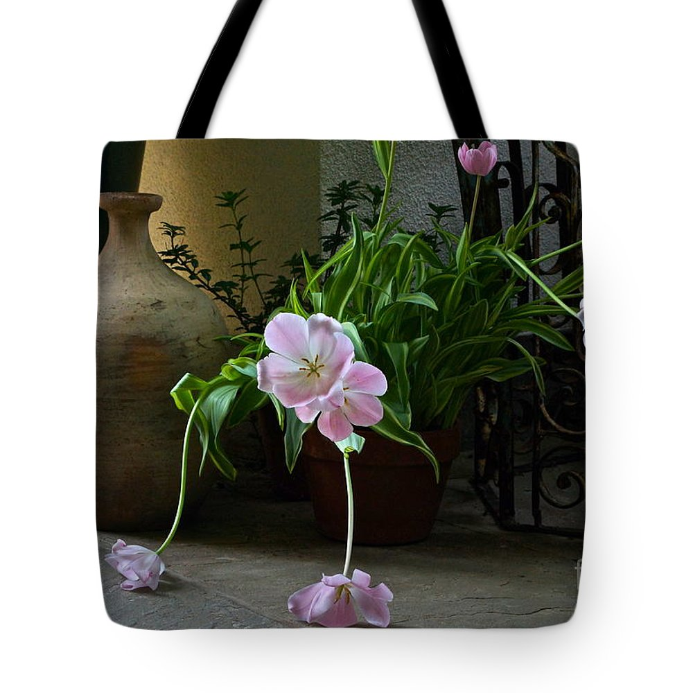 Tulip Still Life Tote Bag featuring the photograph Tulips With Earthenware Jar And Wrought Iron by Byron Varvarigos