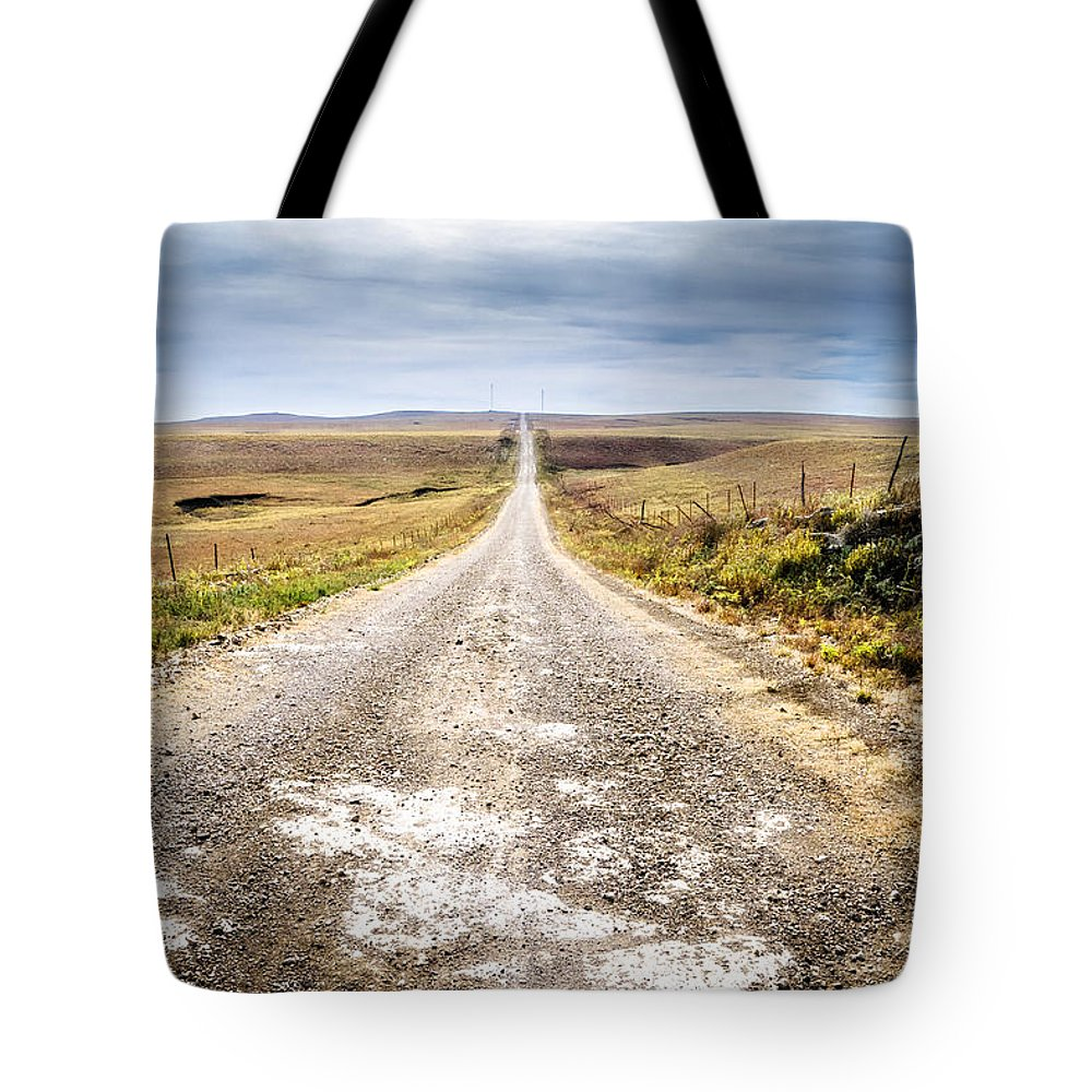 Flint Hills Tote Bag featuring the photograph Twin Towers Road by Eric Benjamin