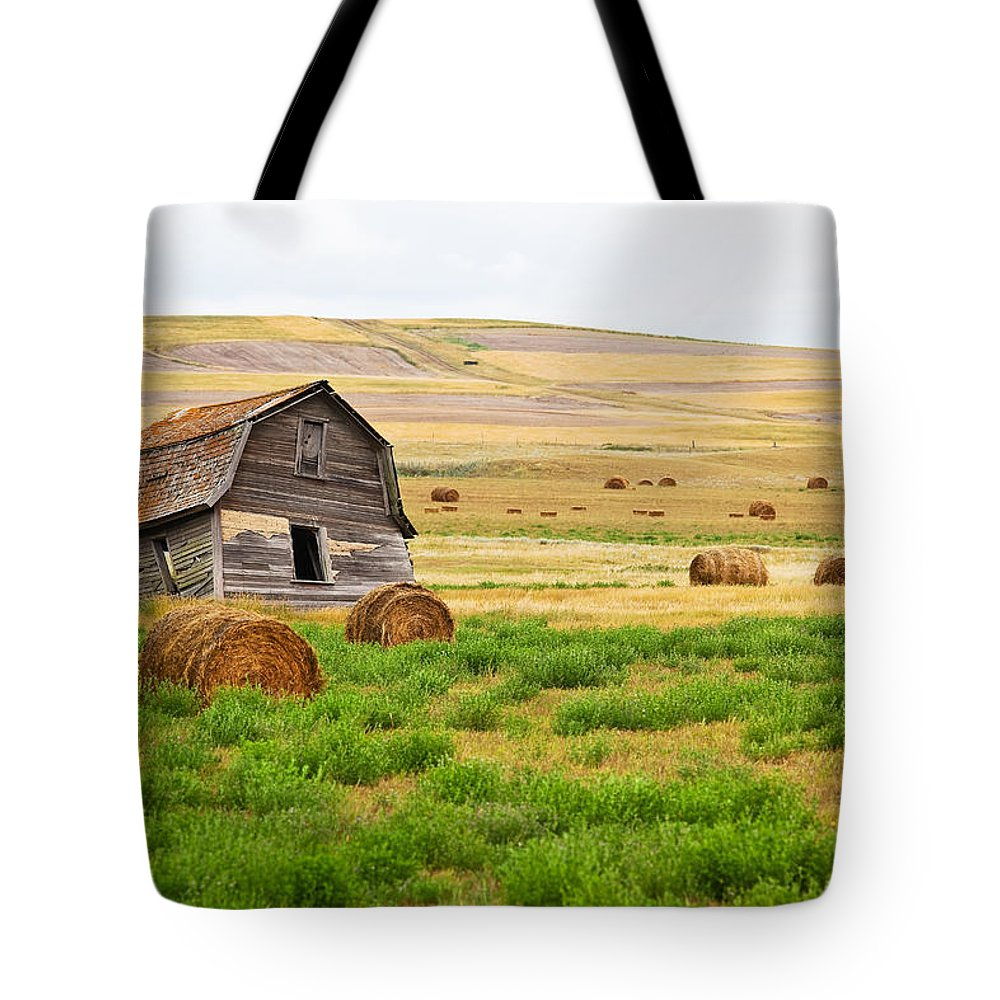 Light Tote Bag featuring the photograph Twisted Barn On Canadian Prairie, Big by Ken Gillespie