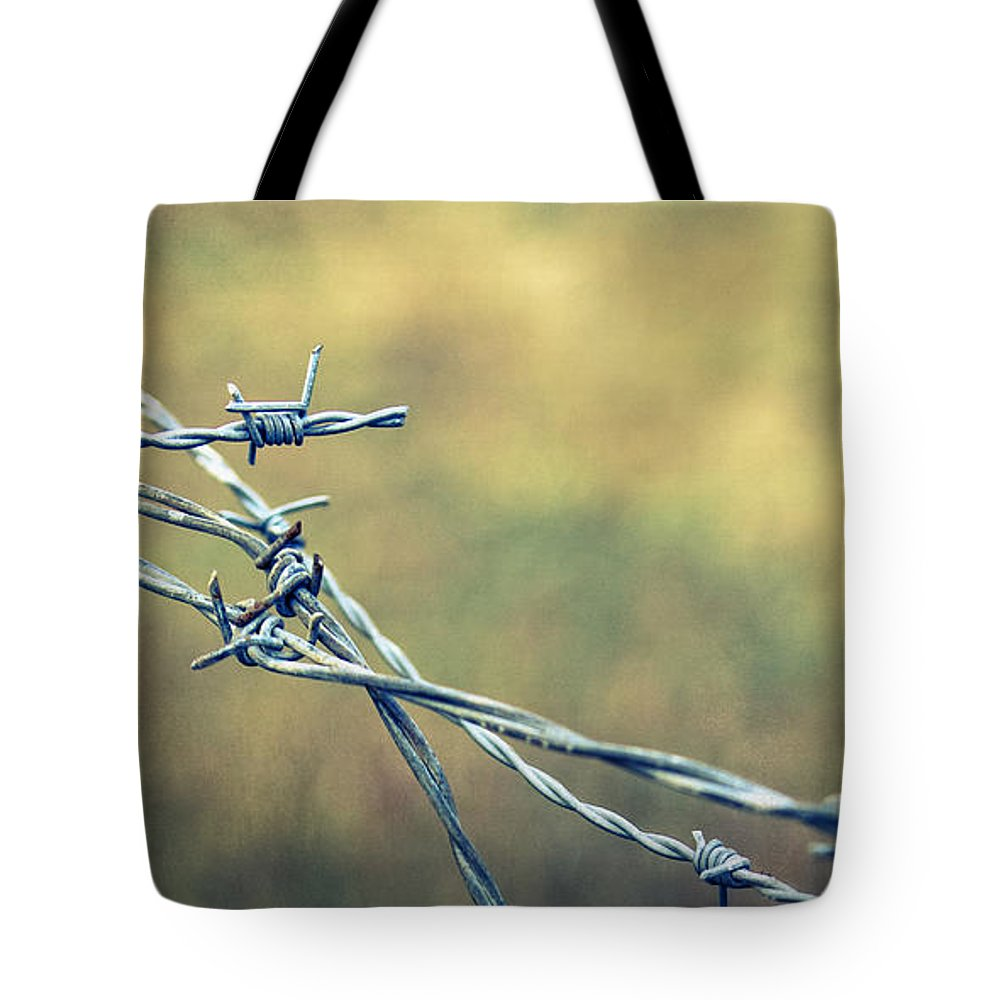 Barbed Wire Tote Bag featuring the photograph Twisted II by Caitlyn Grasso