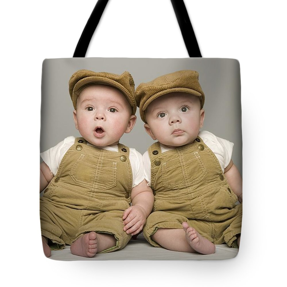 Sibling Tote Bag featuring the photograph Two Babies In Matching Hat And Overalls by Kelly Redinger