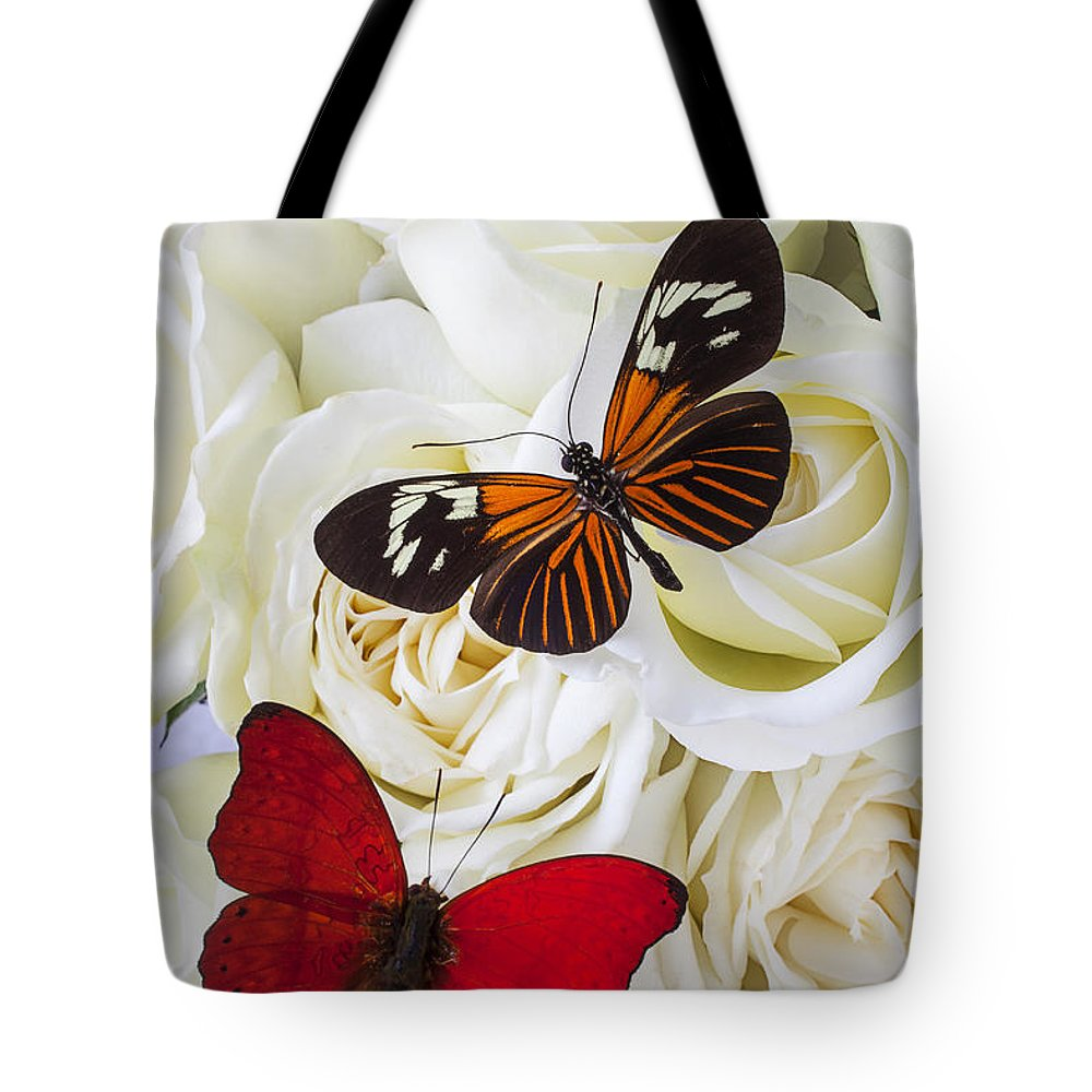Two Butterfly Tote Bag featuring the photograph Two Butterflies On White Roses by Garry Gay