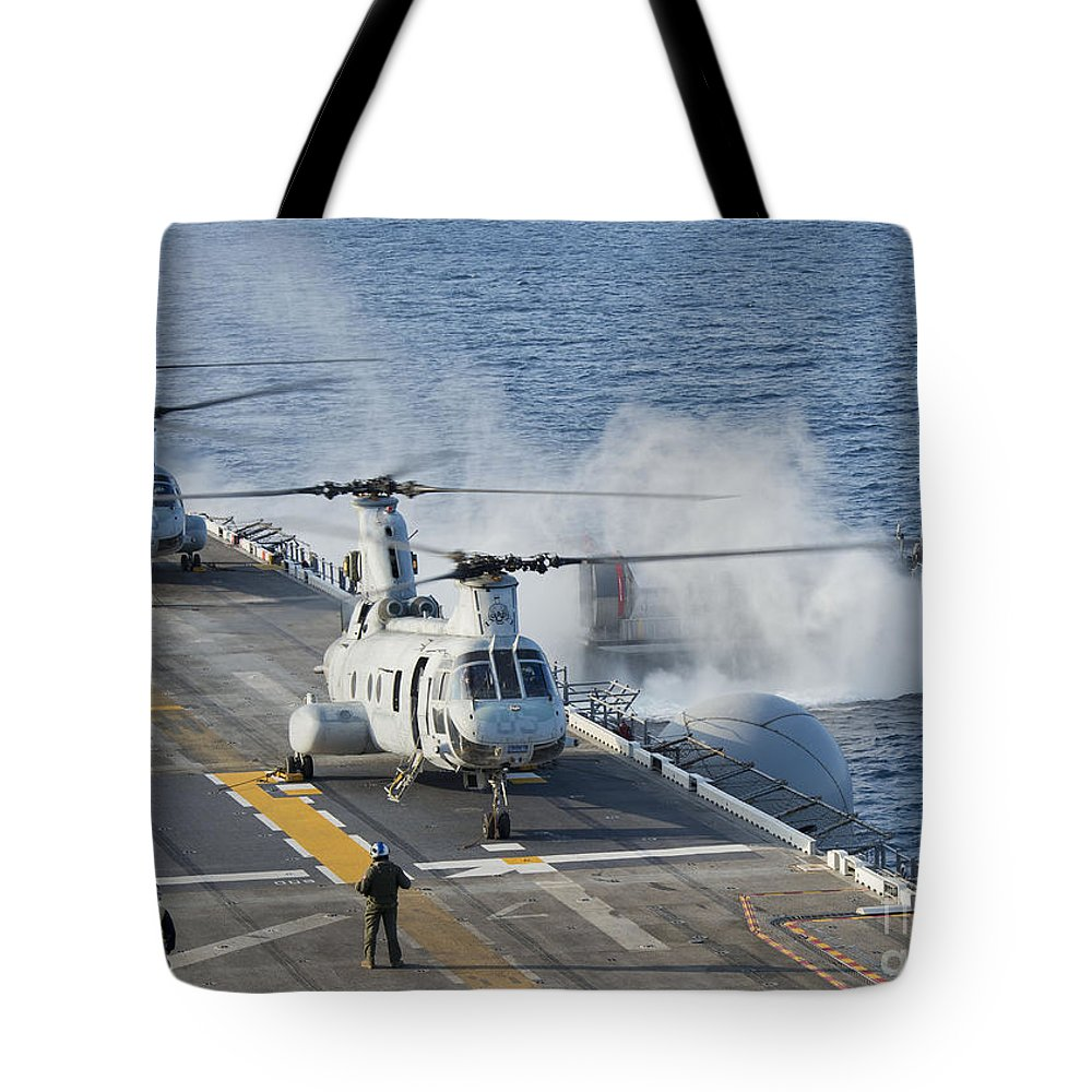 Military Tote Bag featuring the photograph Two Ch-46e Sea Knight Helicopters by Stocktrek Images