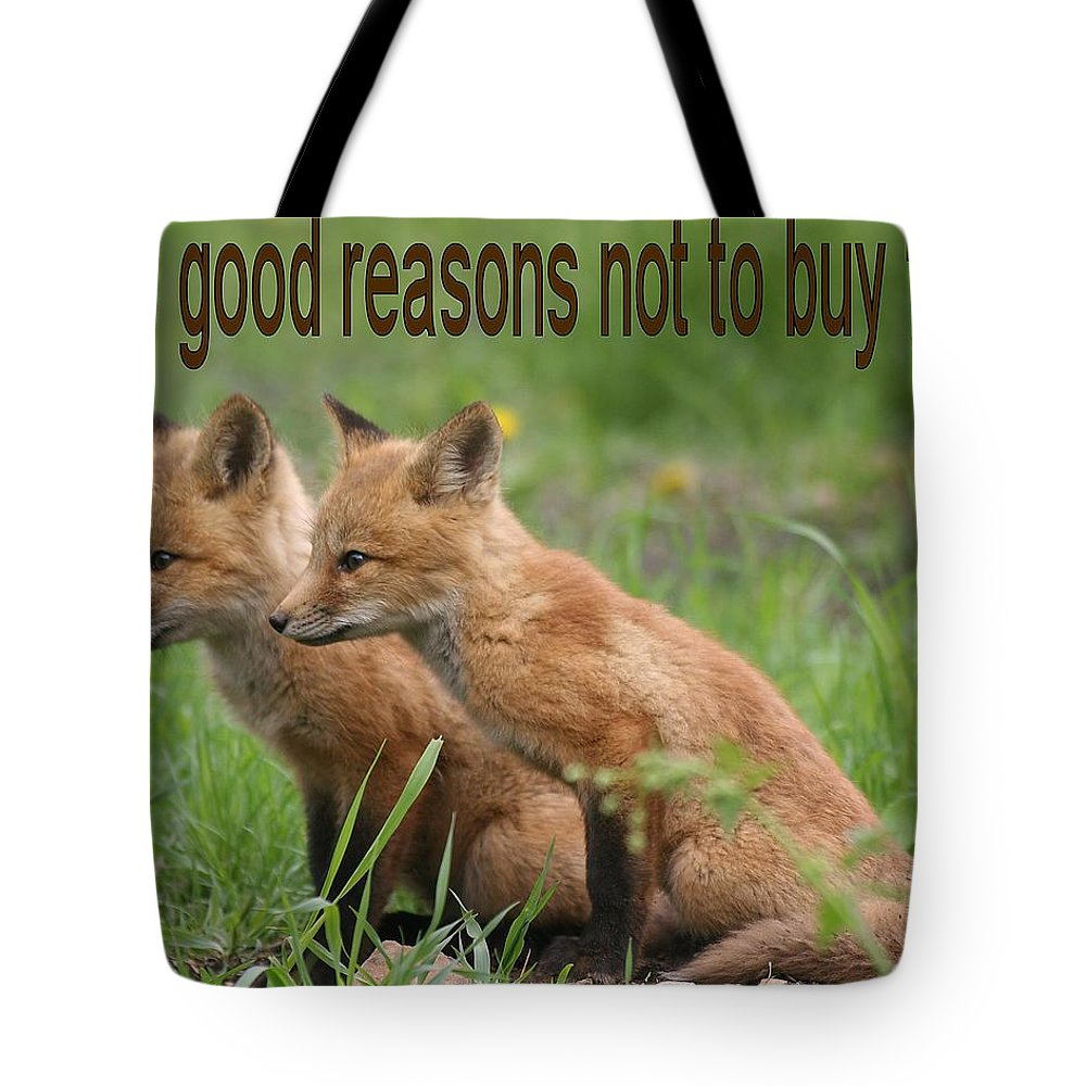 Fox Tote Bag featuring the photograph Two Good Reasons Not To Buy Fur by Doris Potter
