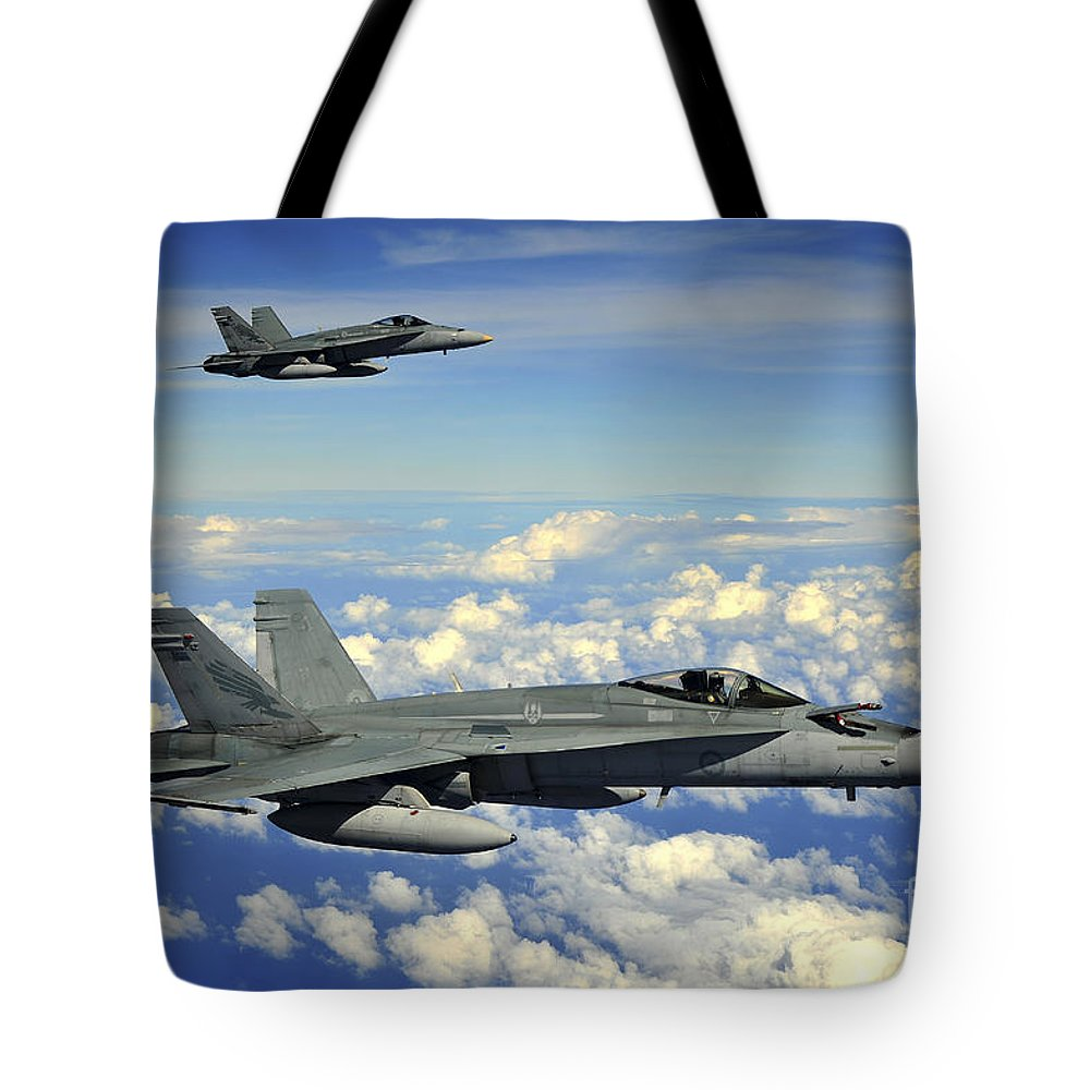 Guam Tote Bag featuring the photograph Two Royal Australian Air Force Fa-18 by Stocktrek Images