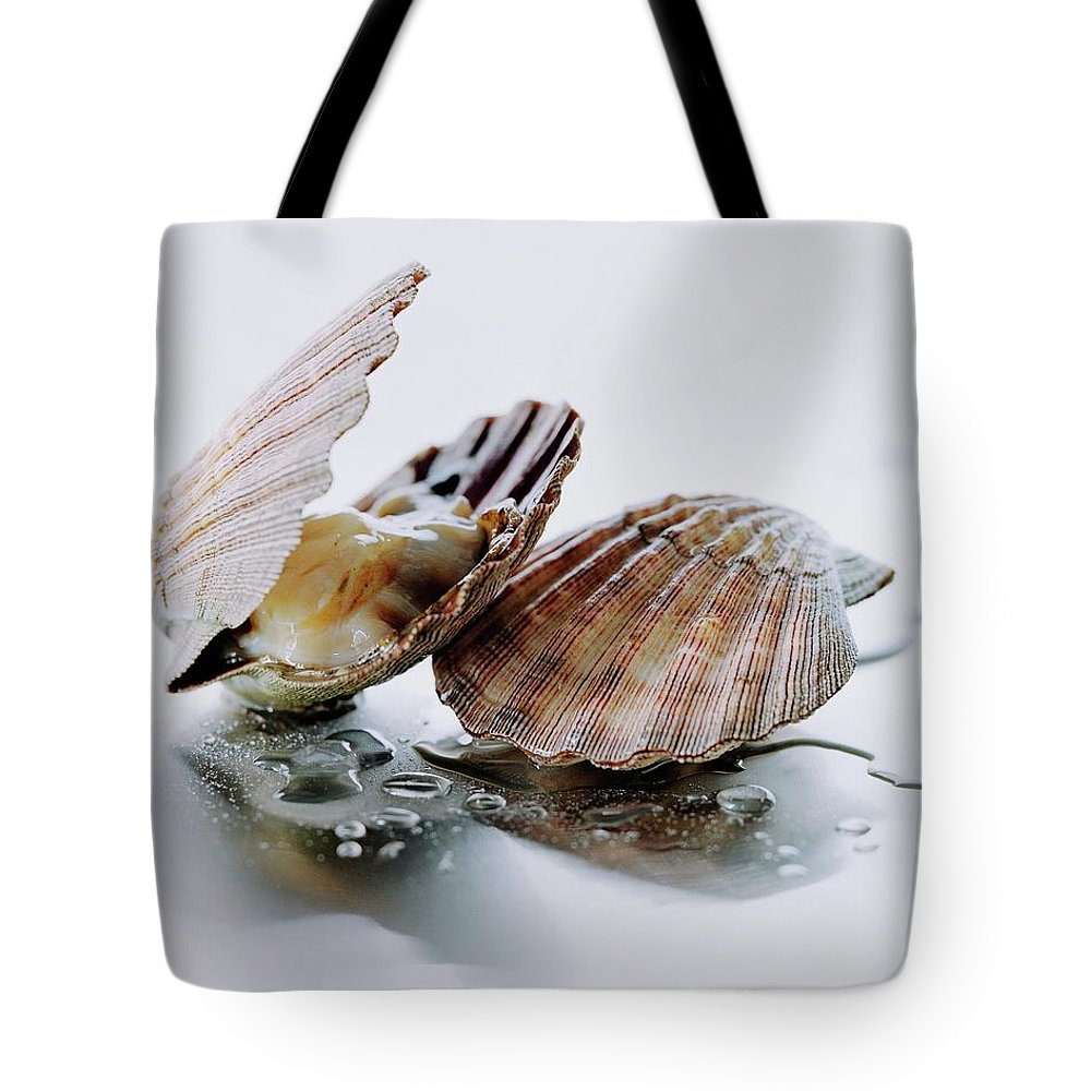 Cooking Tote Bag featuring the photograph Two Scallops by Romulo Yanes