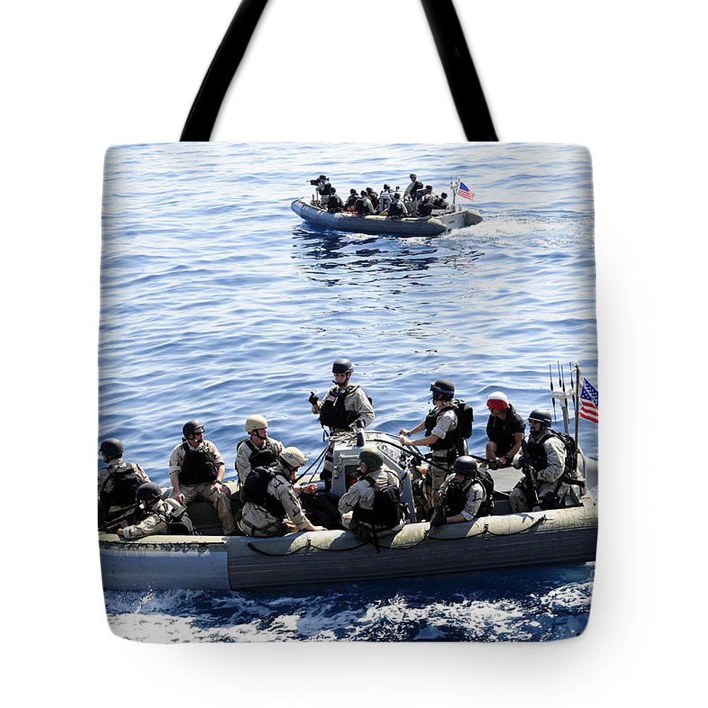 Military Tote Bag featuring the photograph Two Visit, Board, Search And Seizure by Stocktrek Images