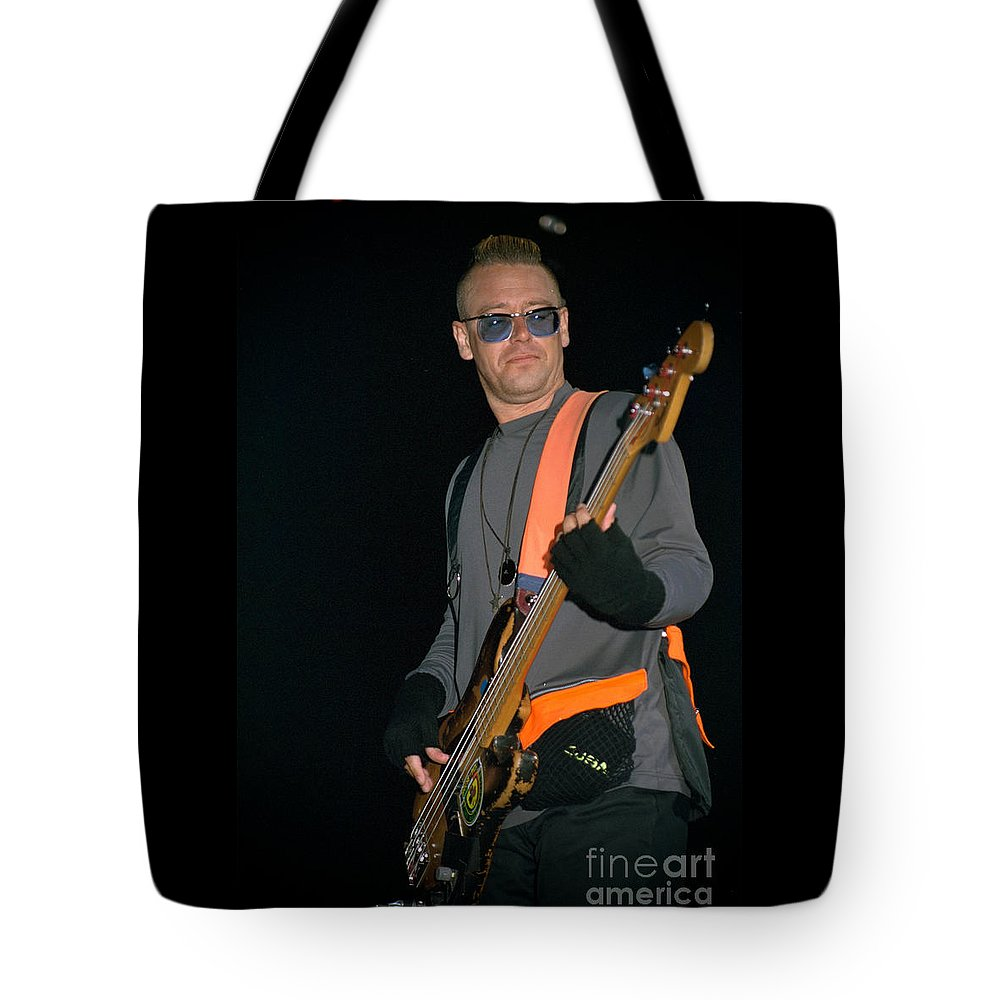 Adam Clayton Tote Bag featuring the photograph U2-adam-gp24 by Timothy Bischoff