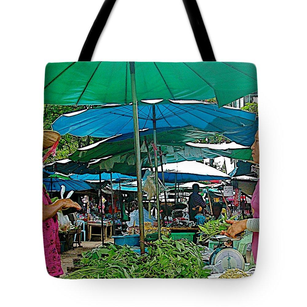 Umbrellas In Marketplace In Tachilek Tote Bag featuring the photograph Umbrellas In The Marketplace In Tachilek-burma by Ruth Hager