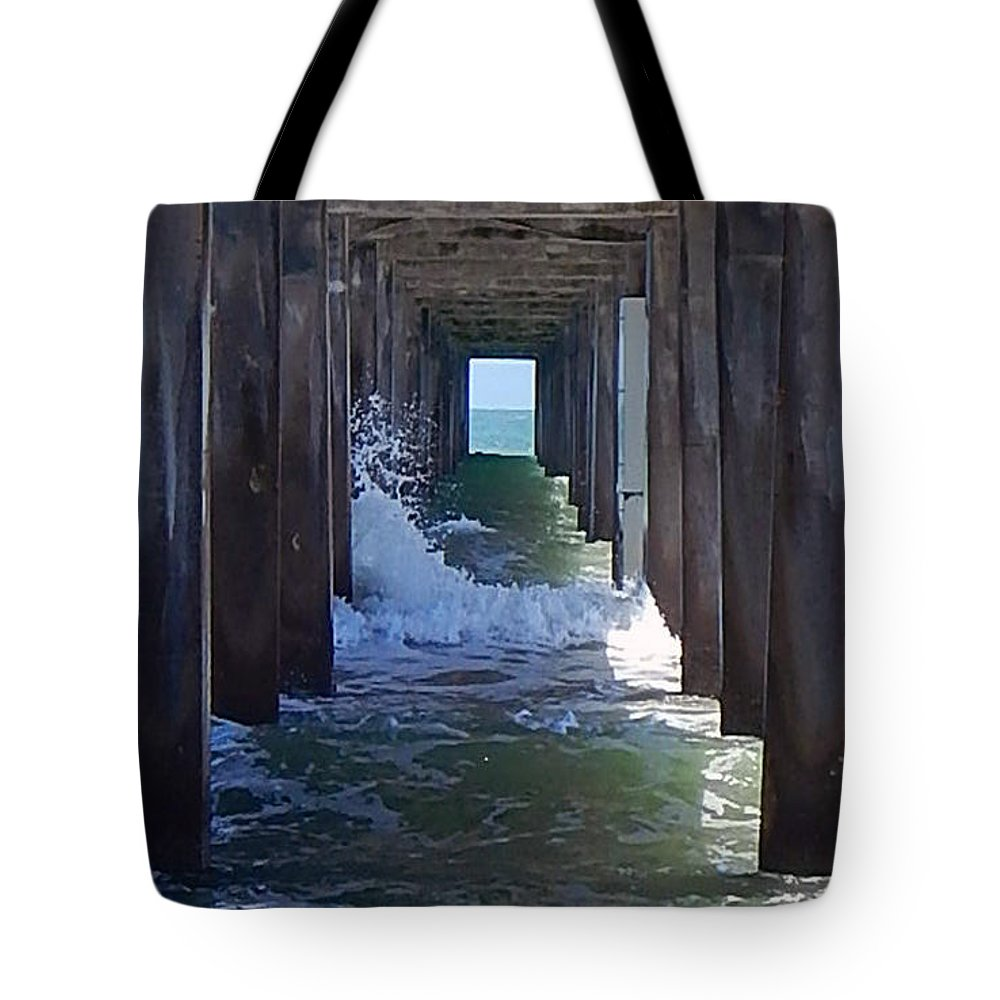 Horace Caldwell Pier Tote Bag featuring the photograph Under The Pier by Anissia Hedrick