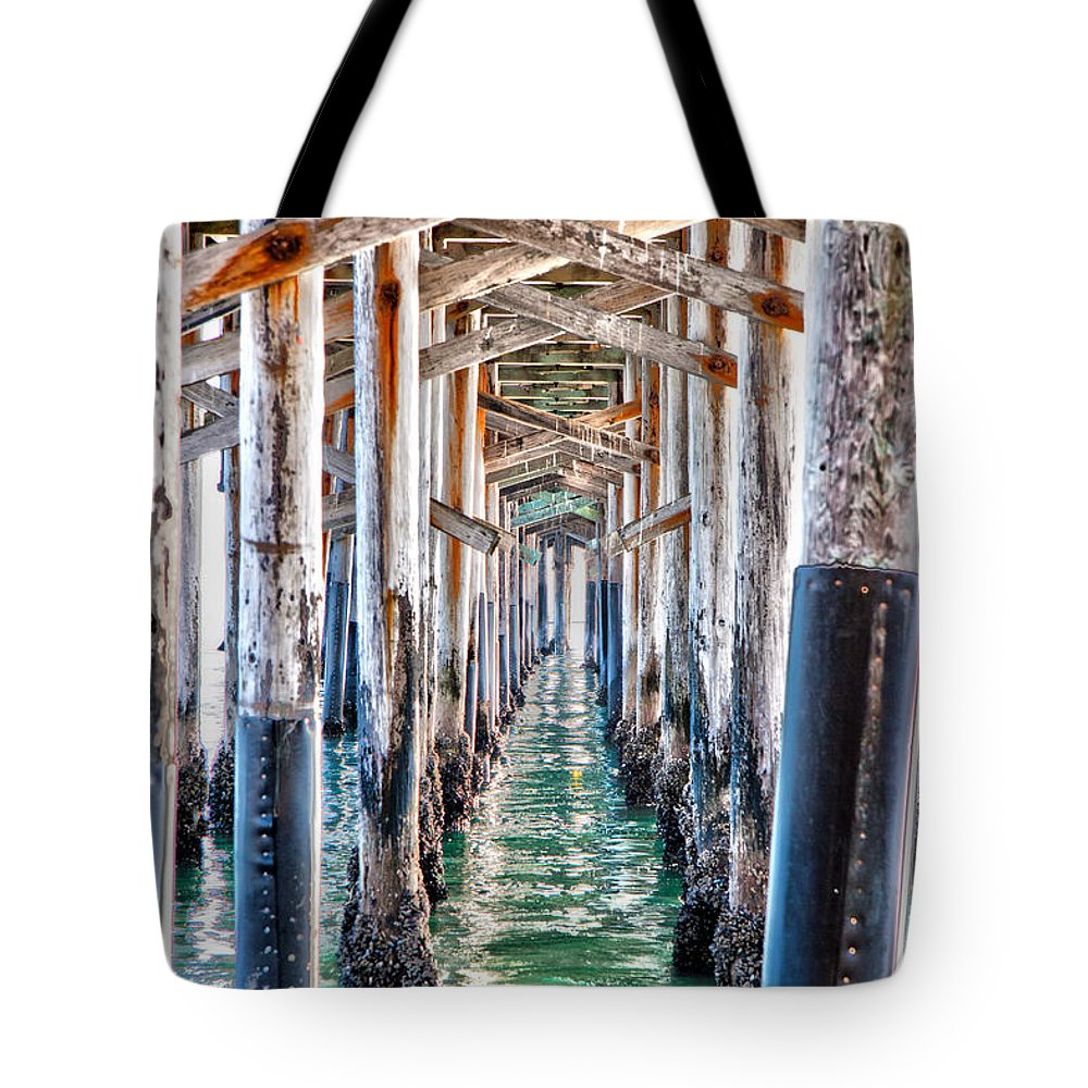 Pier Tote Bag featuring the photograph Under The Pier by Chris Brannen