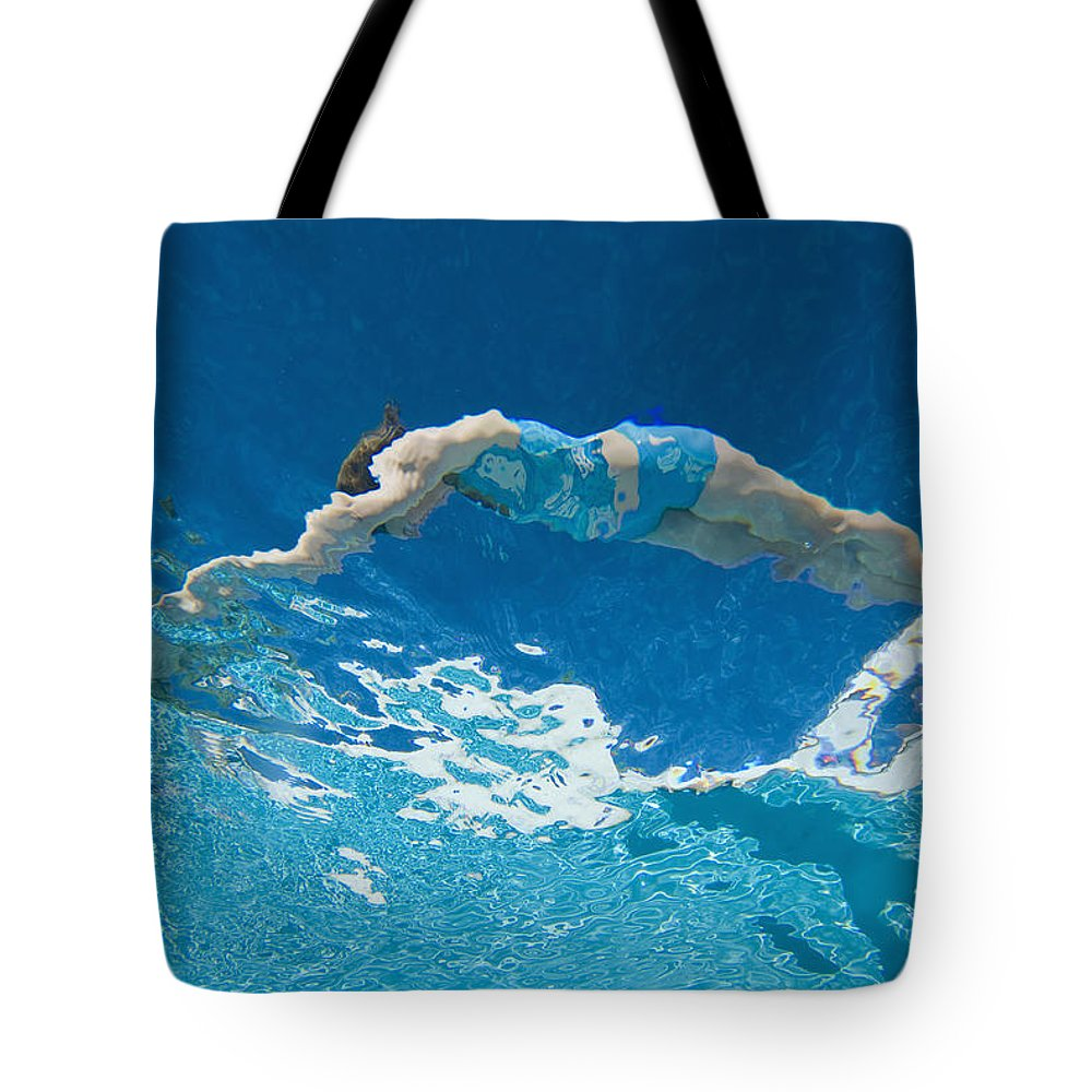 Waters Tote Bag featuring the photograph Underwater View Of Woman Diving Into by Ian Cumming