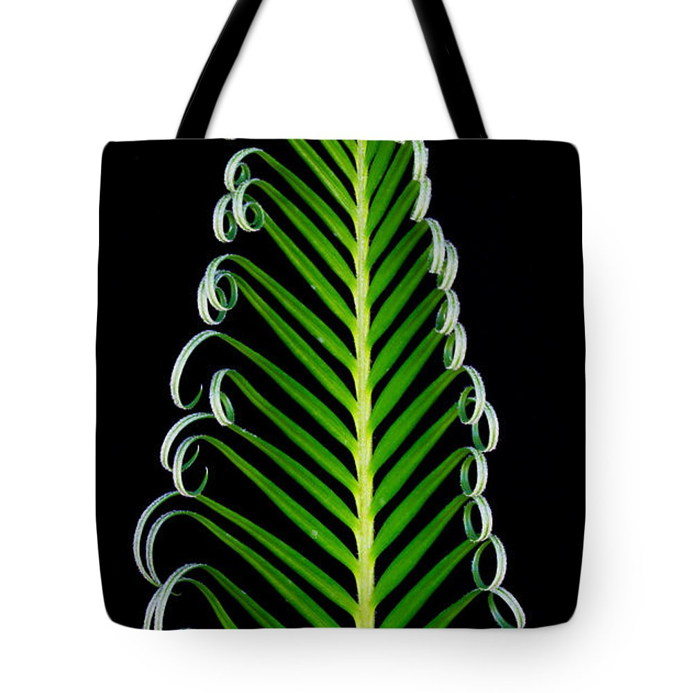 Green Tote Bag featuring the photograph Unfurl by Robert Woodward