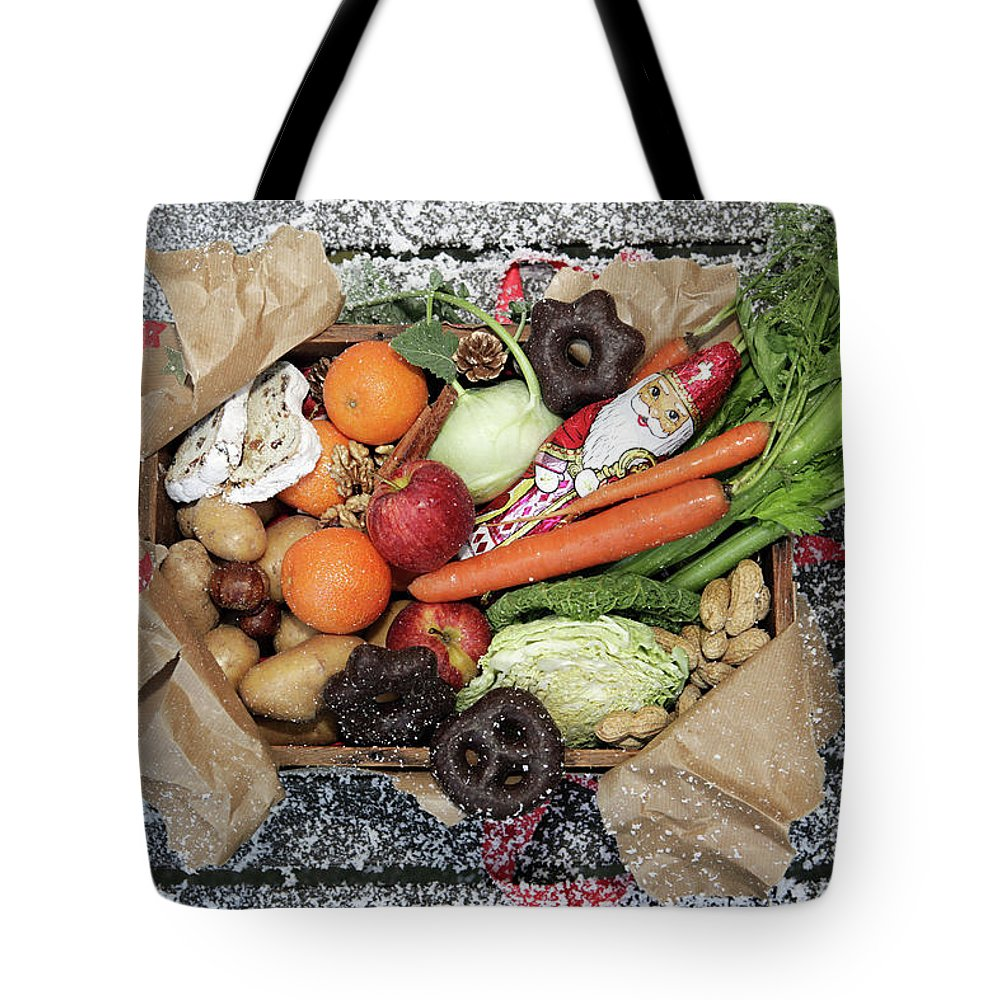 Nut Tote Bag featuring the photograph Unwrapped Box Of Savoury And Sweet by Manuela